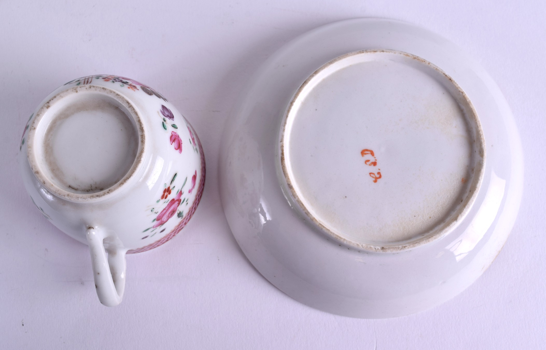 Lot 88 - AN 18TH CENTURY ENGLISH PORCELAIN COFFEE CUP Probably Lowestoft, together with a similar saucer,