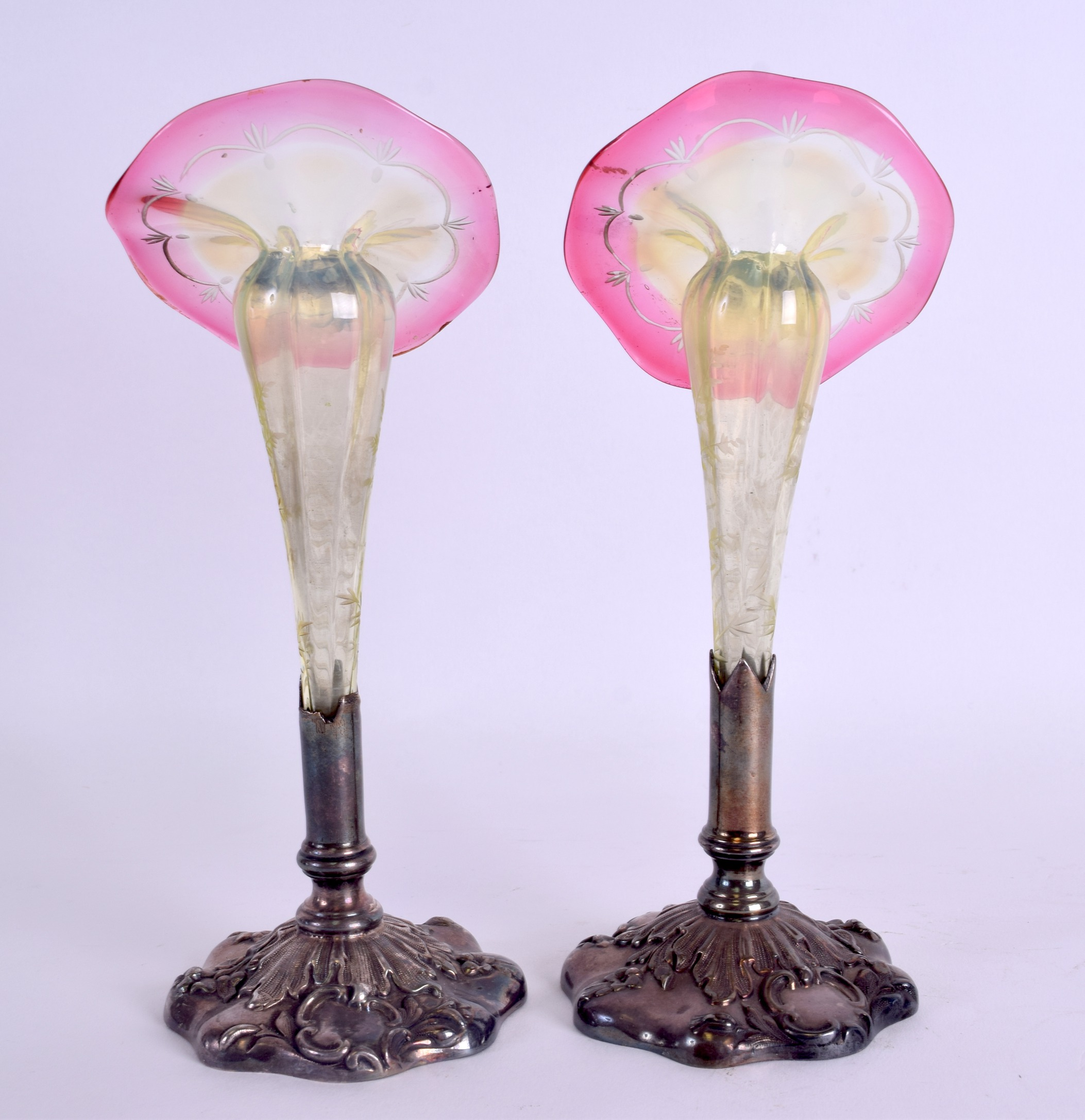 Lot 30 - A LOVELY PAIR OF LATE VICTORIAN GLASS POSY VASES in the manner of Webb, set within embossed silver
