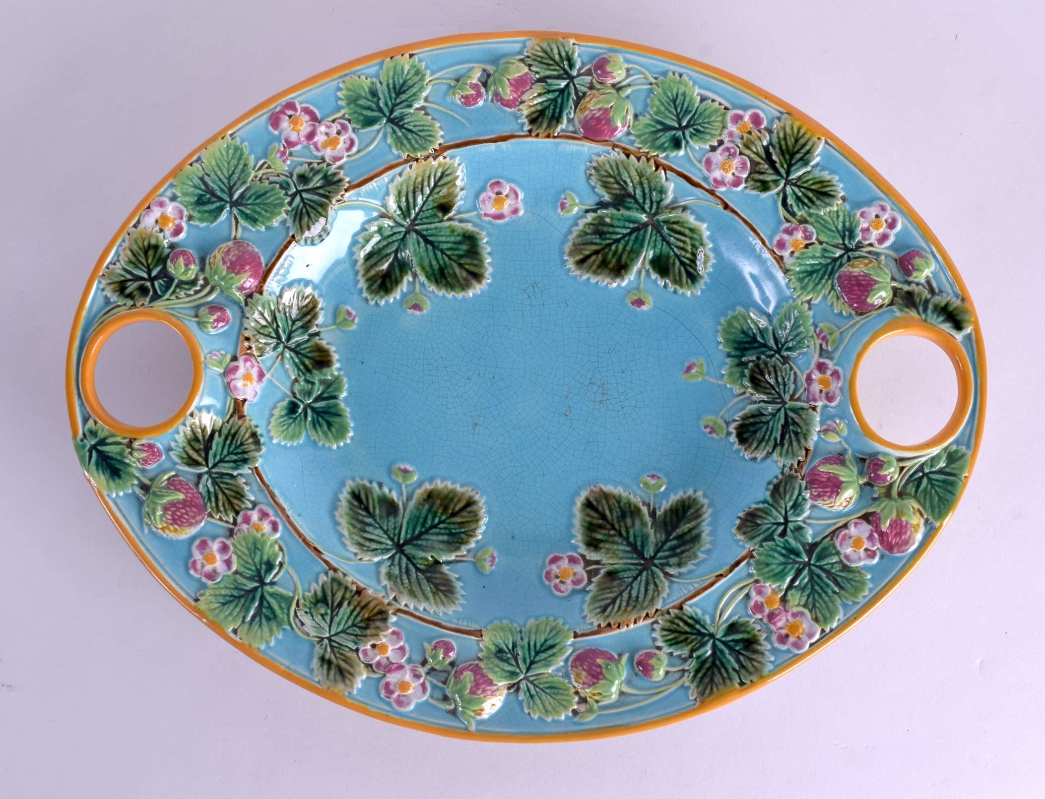 Lot 96 - A LARGE VICTORIAN GEORGE JONES TWIN HANDLED STRAWBERRY DISH decorated with fruiting vines. 37 cm x