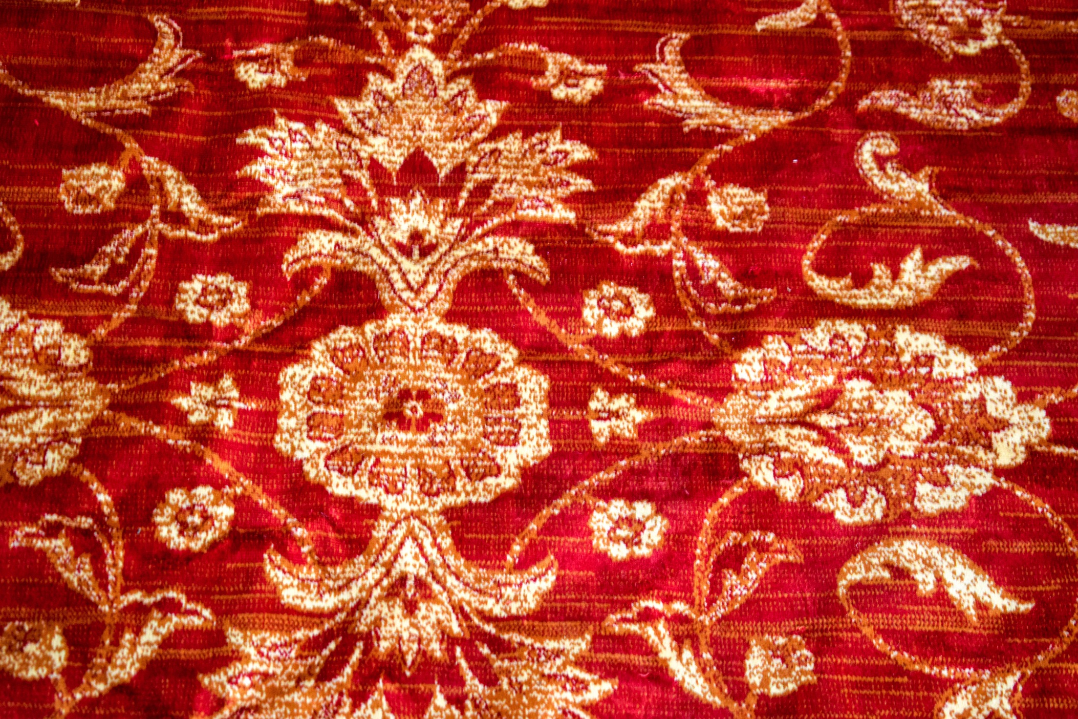 Lot 2930 - A 20TH CENTURY ZIEGLER RED GROUND RUG, decorated with foliage. 230 cm x 160 cm.