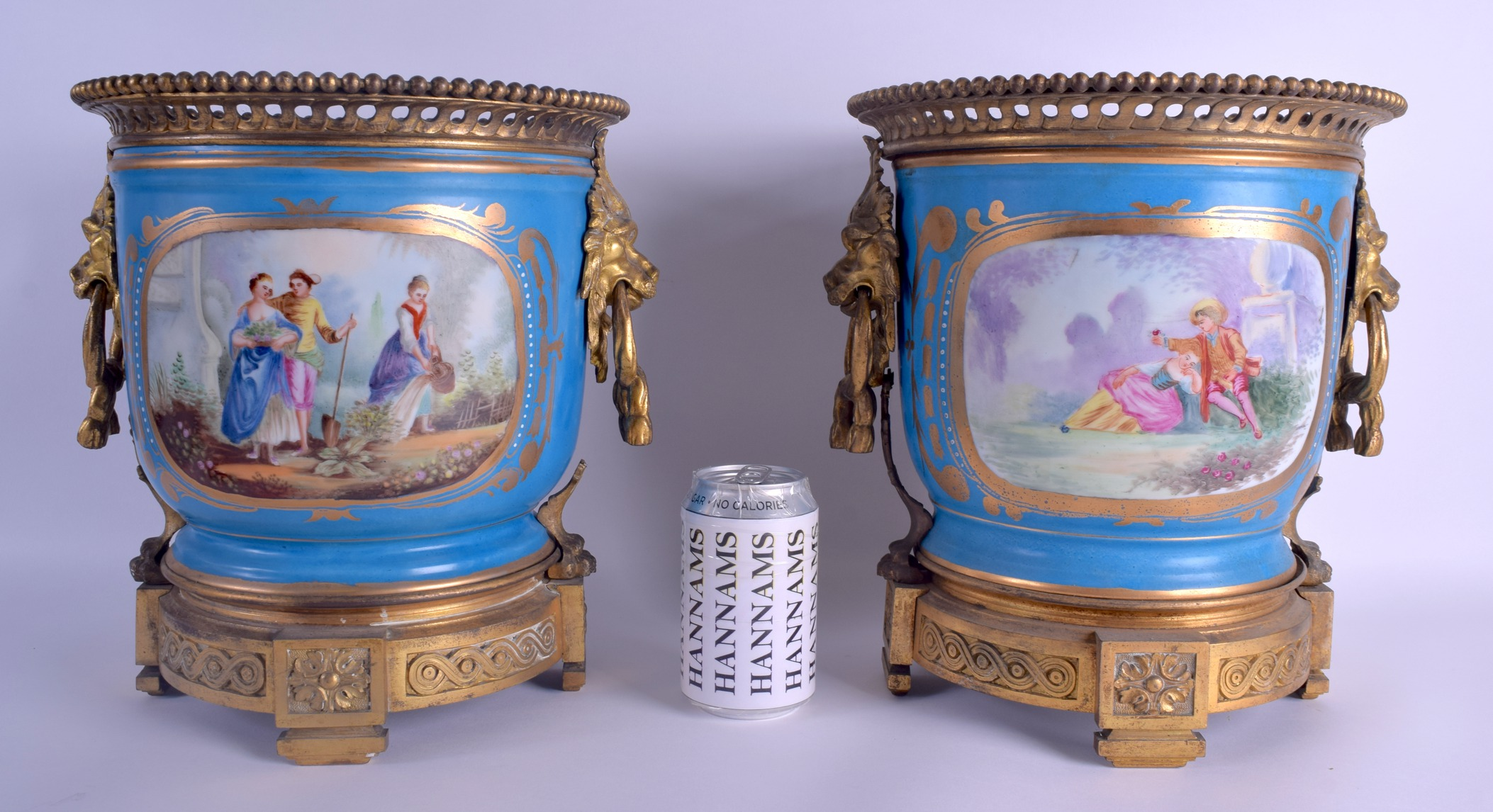 Lot 84 - A LARGE PAIR OF 19TH CENTURY FRENCH SEVRES PORCELAIN JARDINIERES with gilt bronze mask head