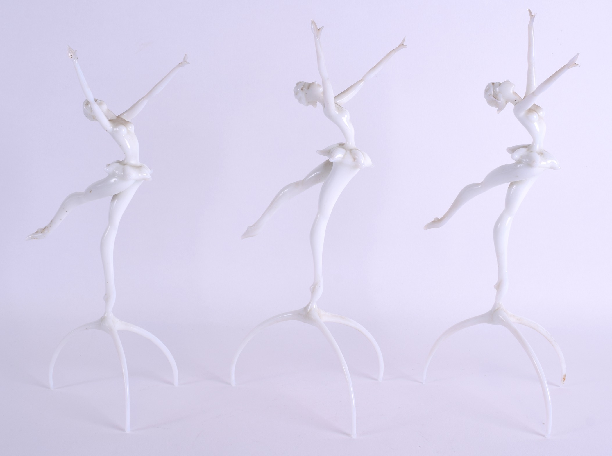 Lot 16 - A RARE SET OF THREE GERMANIC HUNGARIAN GLASS DANCERS by Istvan Komaromy (1910-1975), modelled as