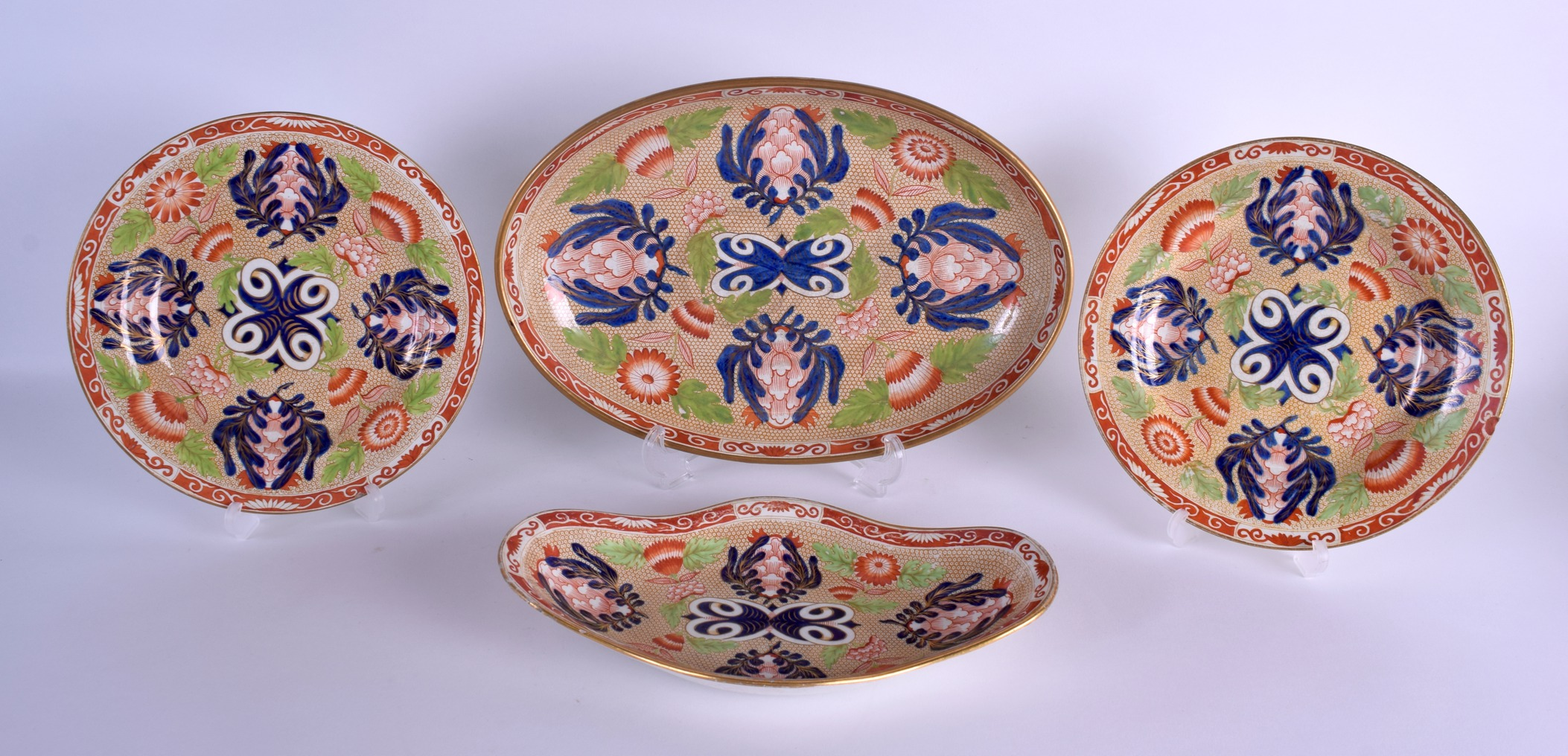 Lot 57 - AN EARLY 19TH CENTURY WEDGWOOD IMARI OVAL DISH together with a pair of plates & a smaller dish.