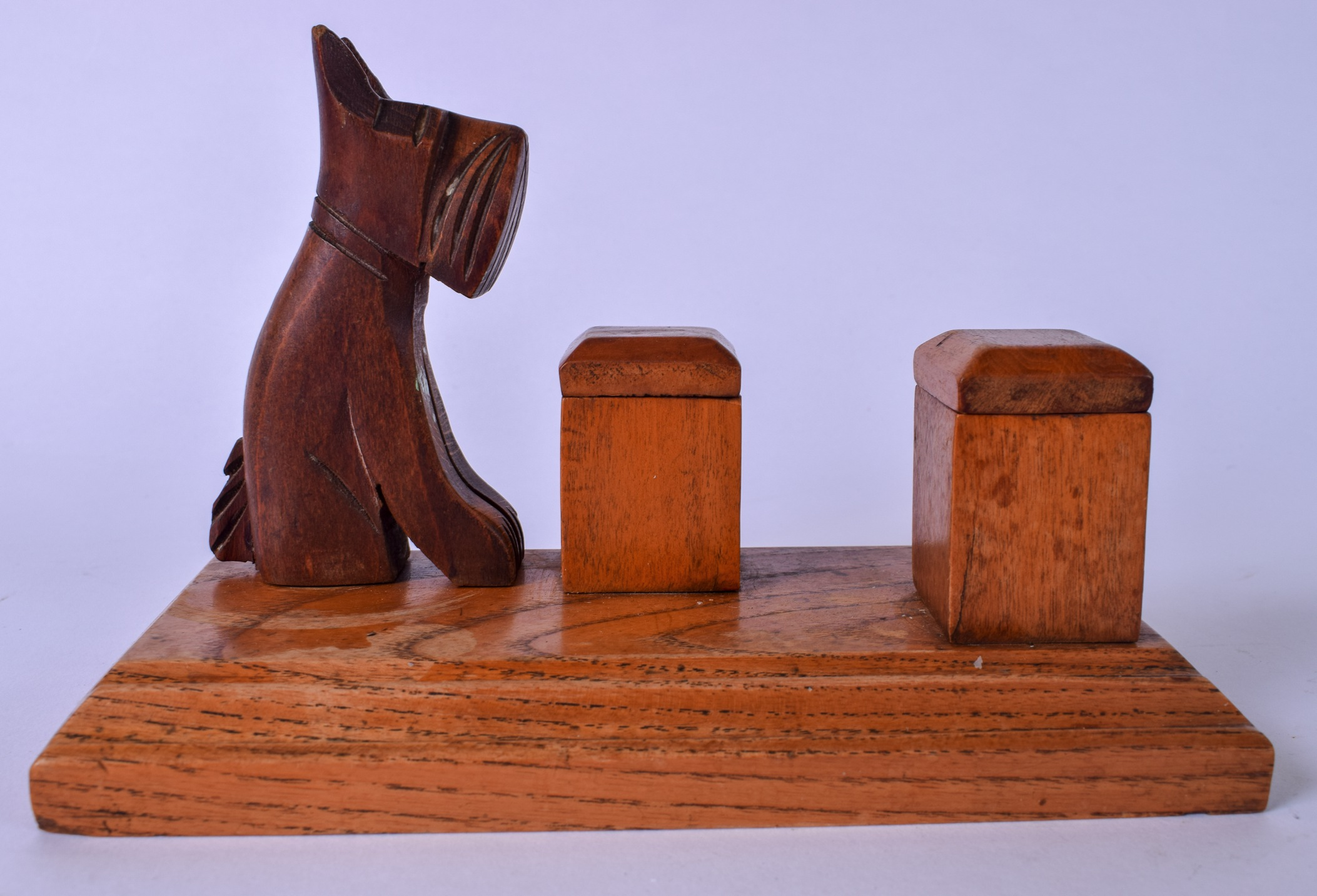 Lot 2410 - AN EARLY 20TH CENTURY CARVED OAK INKWELL, decorated with a carved scottie dog. 13.5 cm x 19.5 cm.