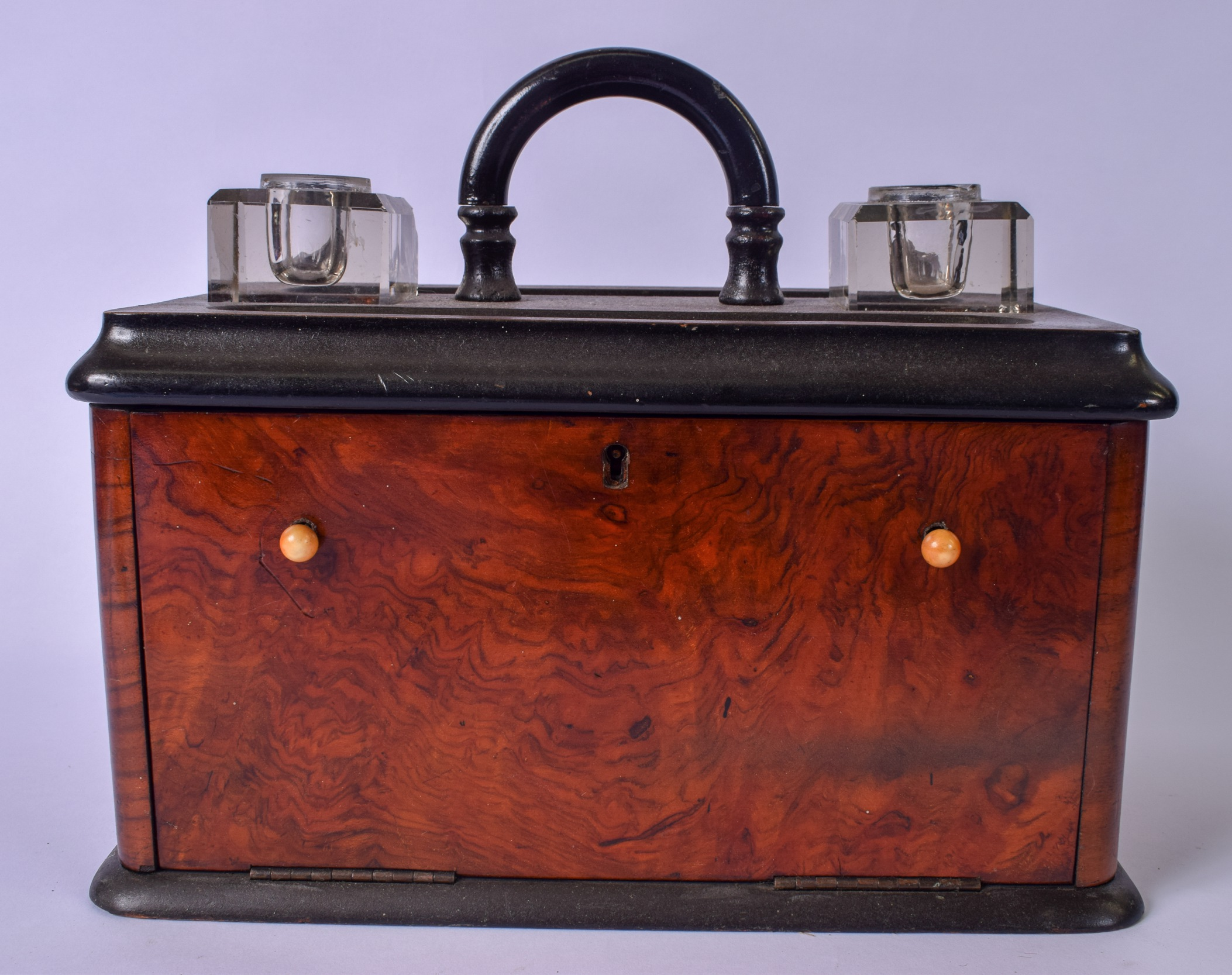 Lot 2816 - AN ANTIQUE WALNUT TRAVELLING STATIONARY BOX WITH INKWELL AND PEN TRAY, opening to reveal letter or