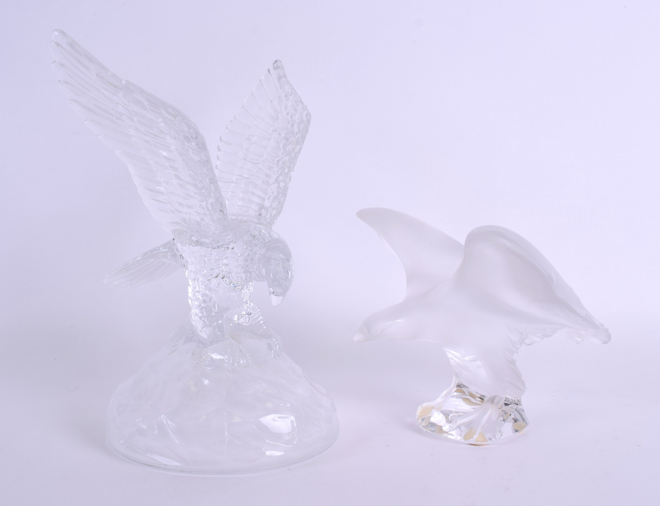 Lot 18 - A FRENCH LALIQUE FIGURE OF A BIRD together with another pressed glass eagle. Lalique 19 cm x 12