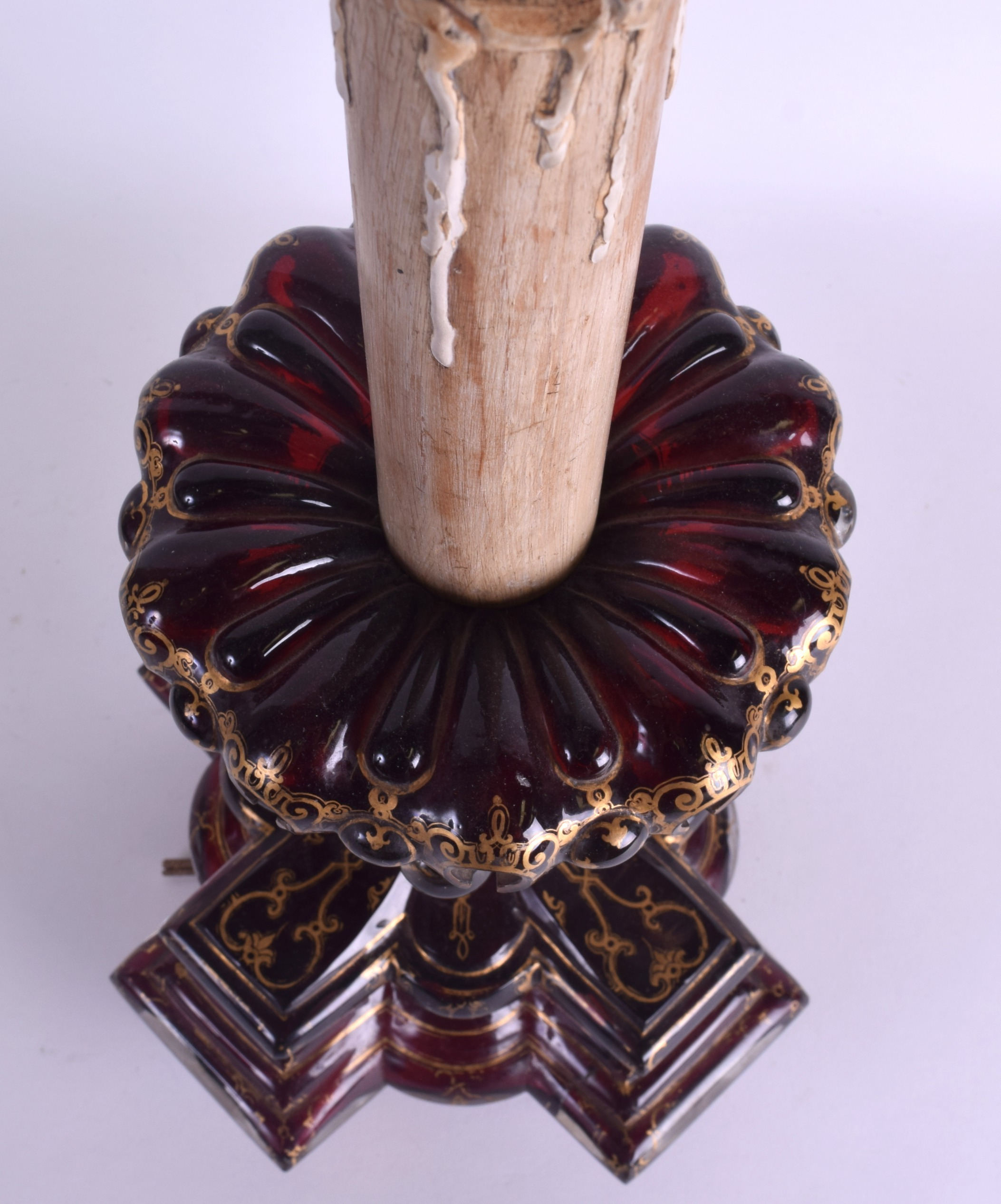 Lot 6 - A RARE LARGE 19TH CENTURY BOHEMIAN RUBY GLASS CANDLESTICK of highly unusual form, overlaid with