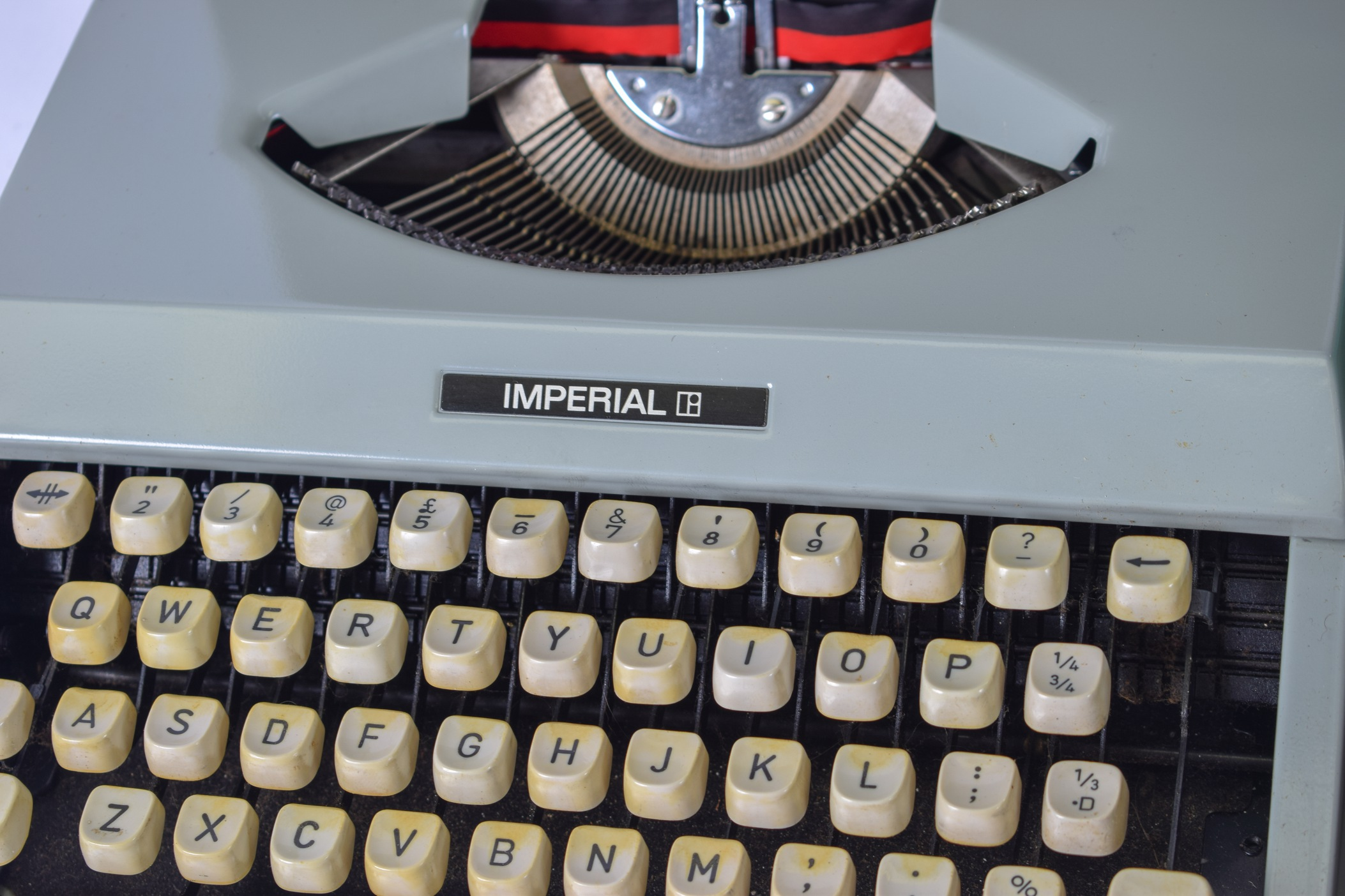 "Lot 2292 - A CASED VINTAGE PETITE TURQOUISE JUNIOR DE LUXE TYPEWRITER, together with a vintage ""Imperial"""