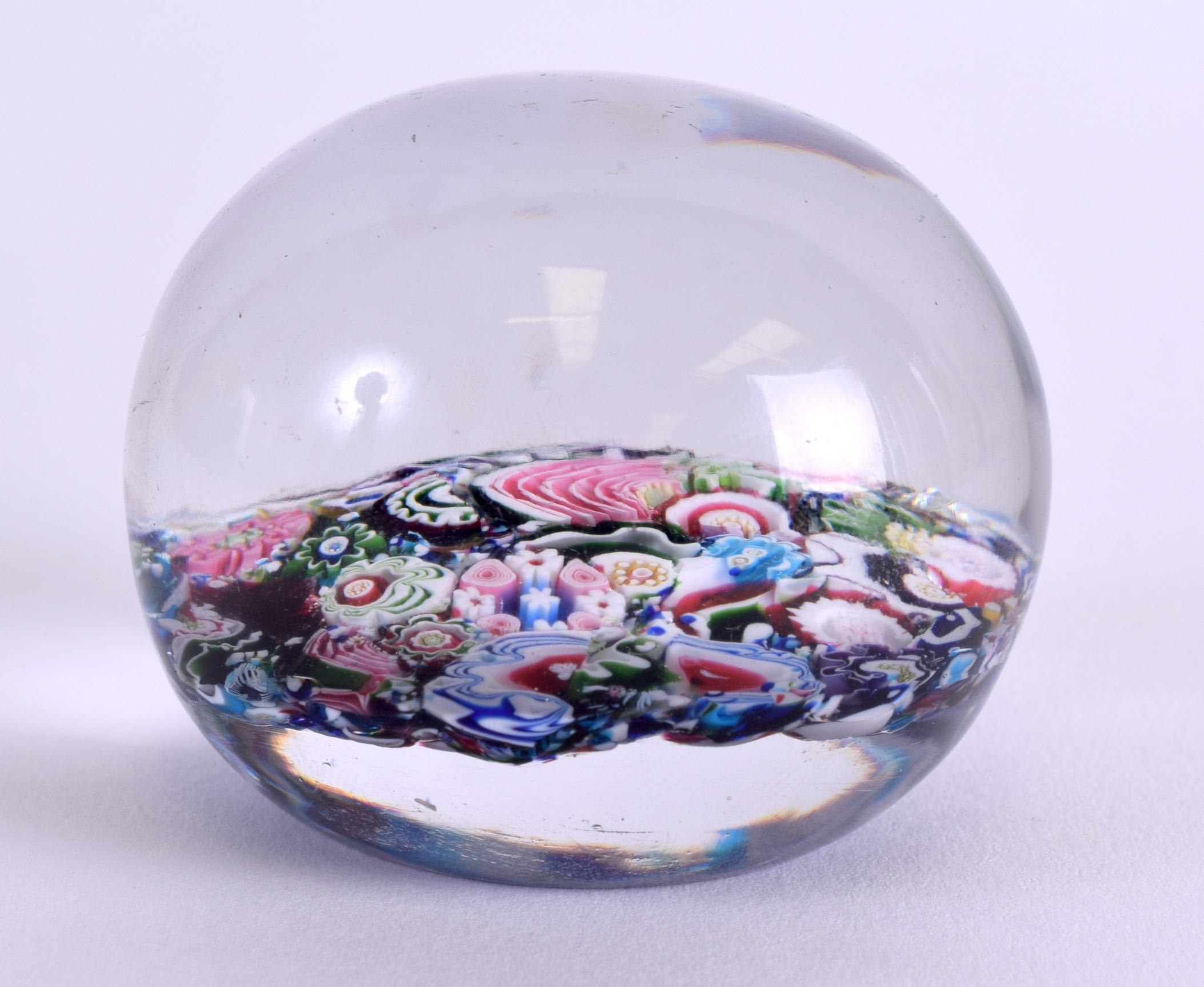 Lot 24 - A 19TH CENTURY FRENCH CLICHY SCRAMBLE PAPERWEIGHT decorated with foliage. 6 cm wide.