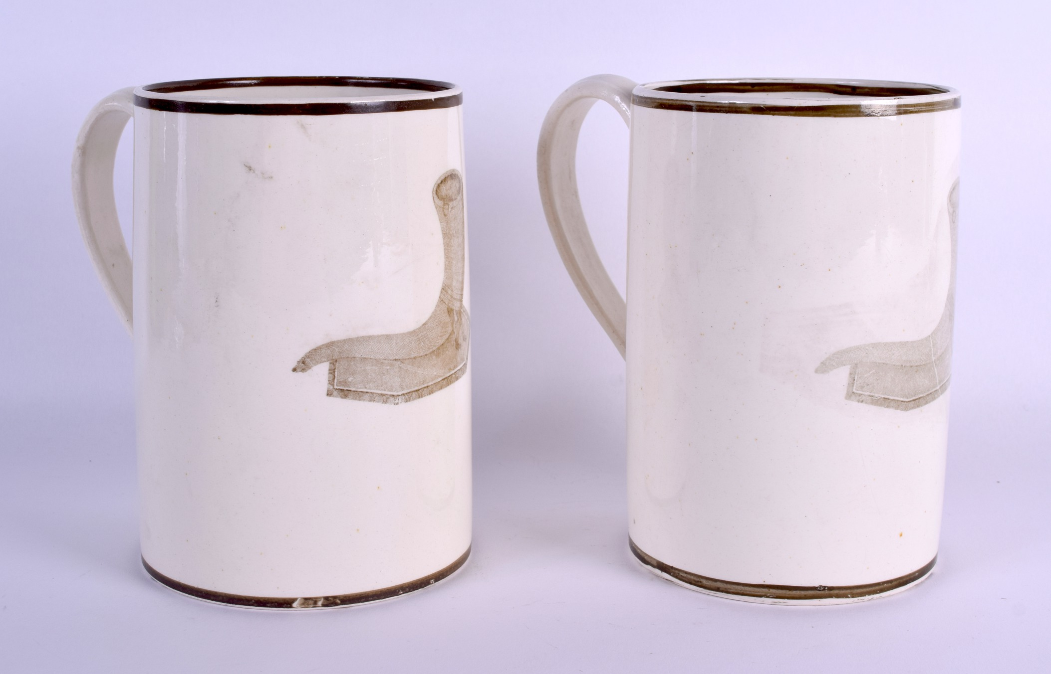 Lot 61 - A RARE PAIR OF EARLY 19TH CENTURY WEDGWOOD CREAMWARE MUGS decorated with cornucopia. 16 cm high.
