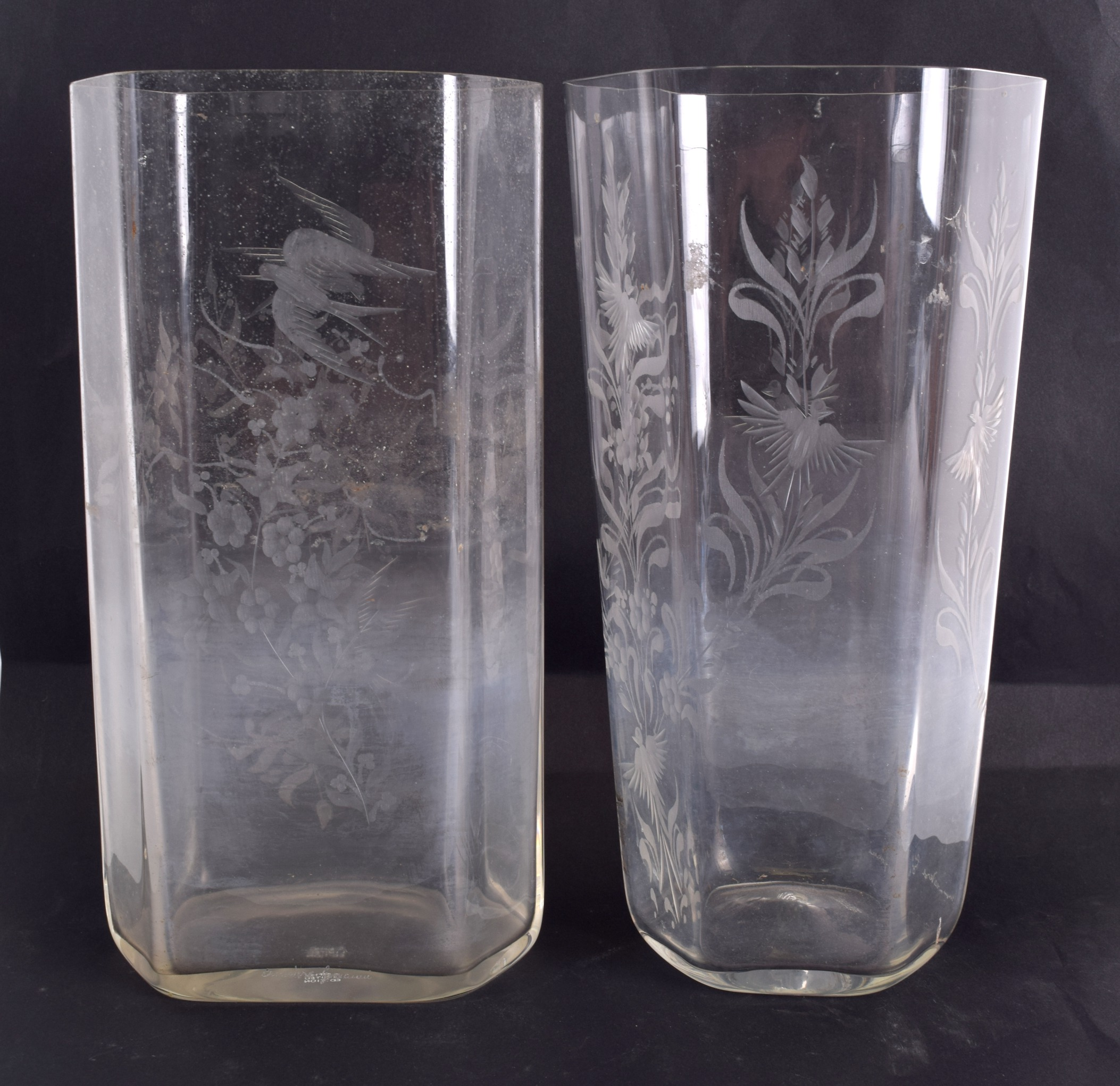 Lot 25 - TWO LIMITED EDITION ETCHED GLASS VASES decorated with birds and foliage. 27 cm & 26 cm high. (2)