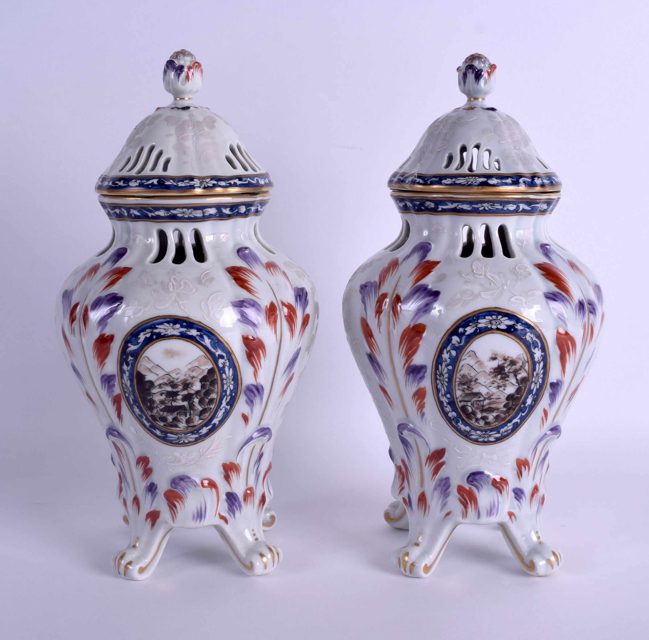 Lot 82 - A PAIR OF 19TH CENTURY FRENCH SAMSONS OF PARIS PORCELAIN VASES AND COVERS painted with landscapes.