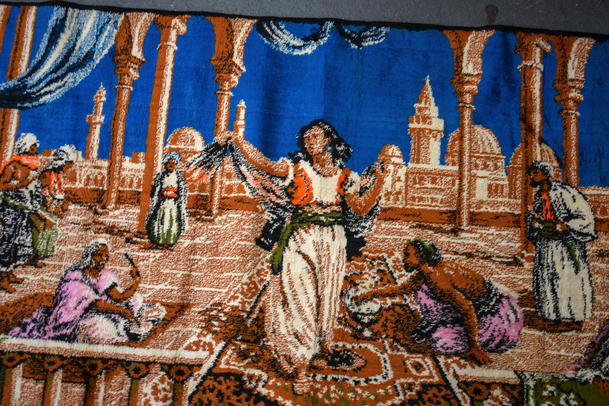 Lot 2600C - THREE EASTERN RUGS, each depicting figures in various pursuits. 49 cm x 145 cm each.