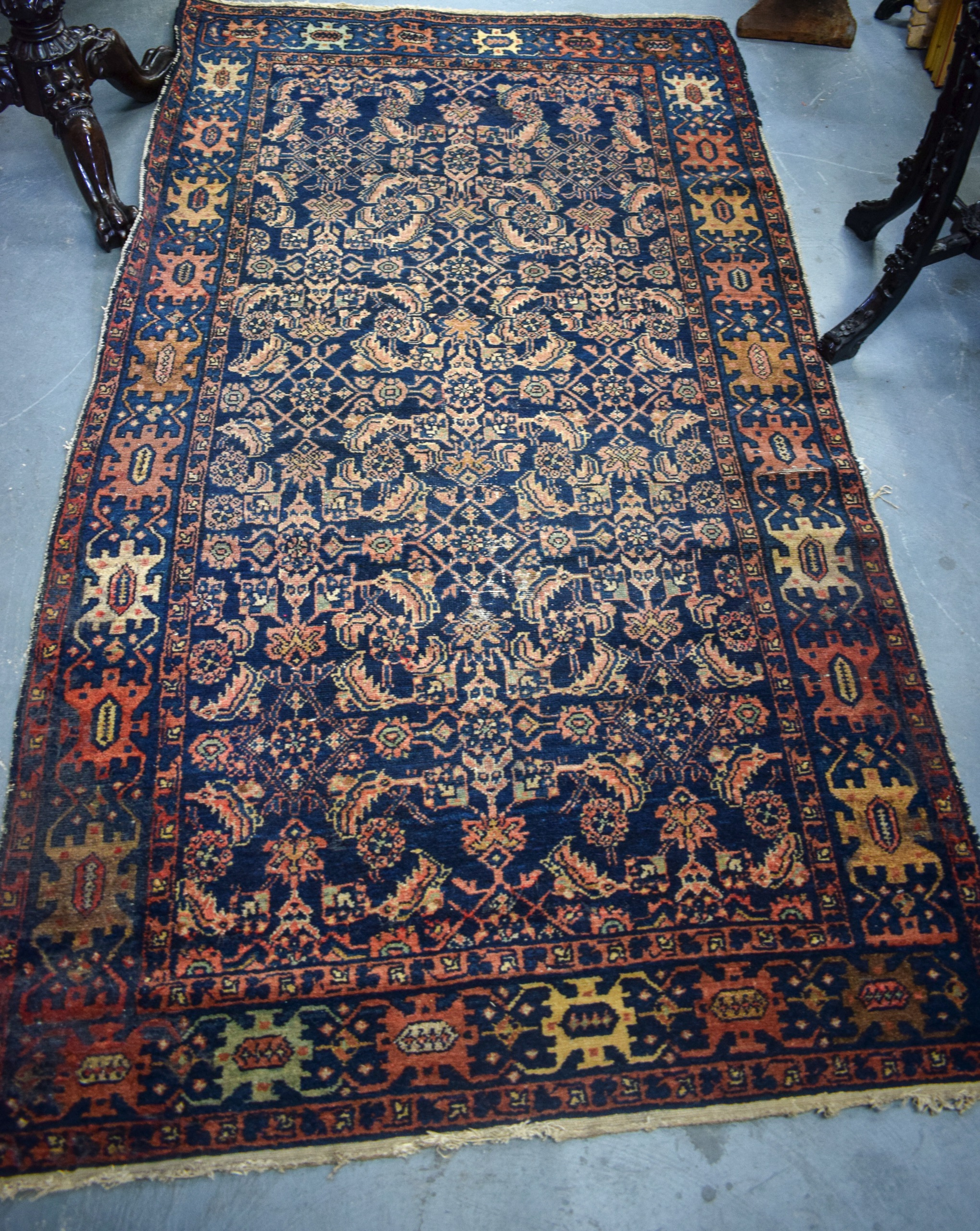 Lot 2600E - AN ANTIQUE BLUE GROUND PERSIAN HERATI RUG, decorated with symbols and motifs. 201 cm x 102 cm.