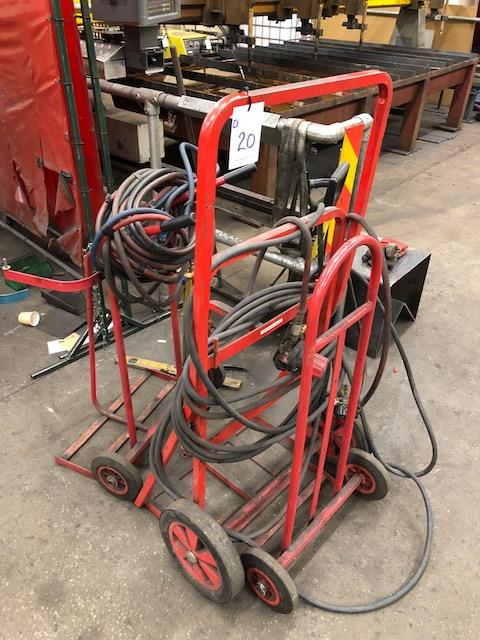 Lot 20 - Two twin and one single cylinder, gas bottle trolleys