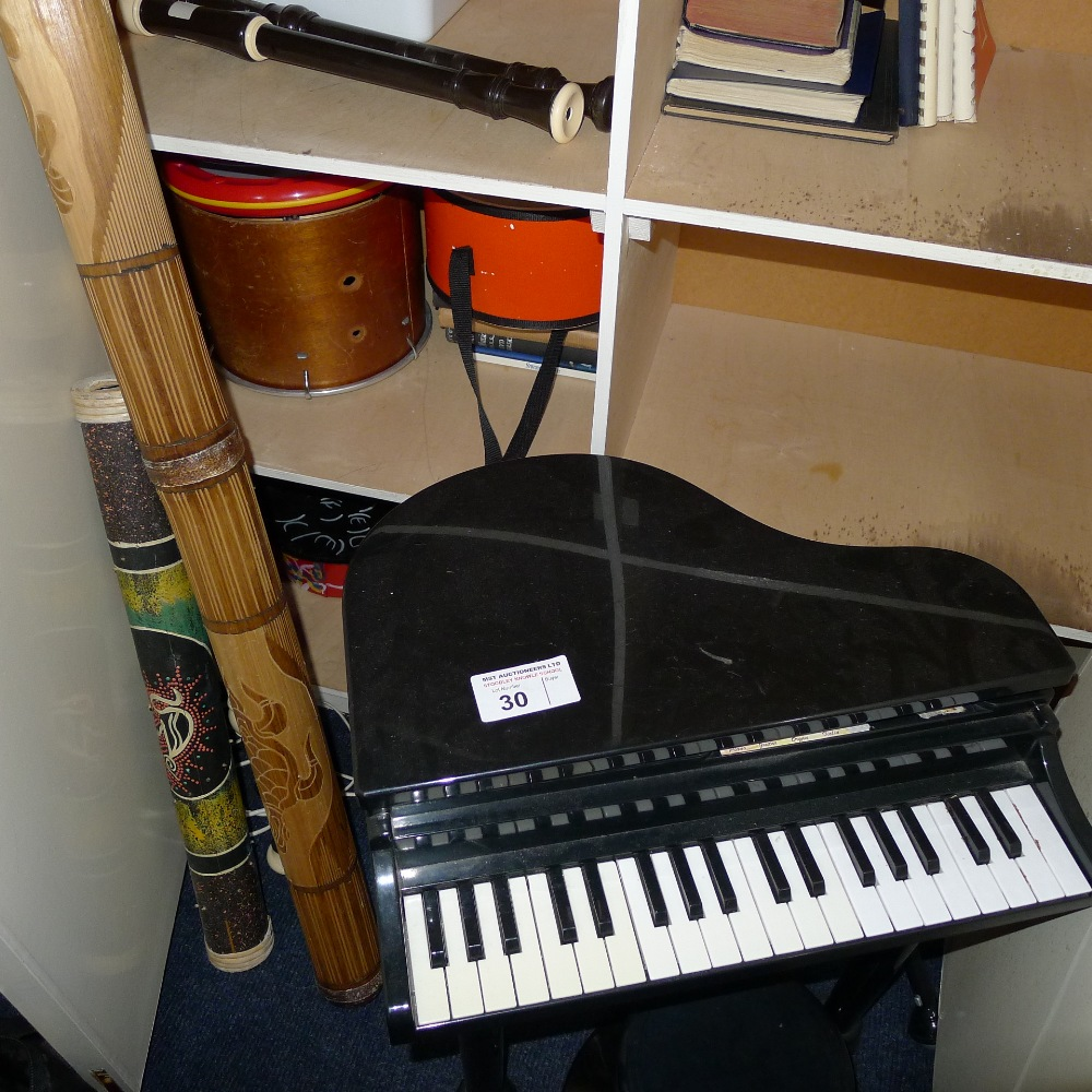 Lot 30 - 1 miniature elect. child's piano, various drums, other percussion and wind instruments etc. (located
