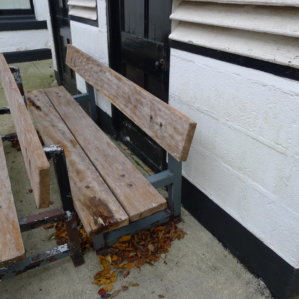 Lot 56 - 1 metal framed timber four seater garden bench (located in front courtyard)