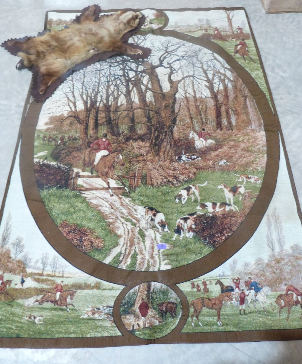 Lot 29 - A textile hunting wall hanging and a badger skin