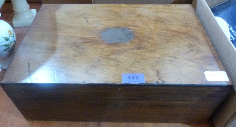 Lot 123 - A Victorian walnut sewing box and contents