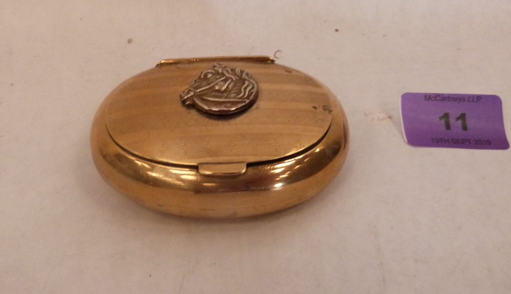 Lot 11 - A brass oval tobacco or snuffbox with applied horse head emblem. 3¼' wide
