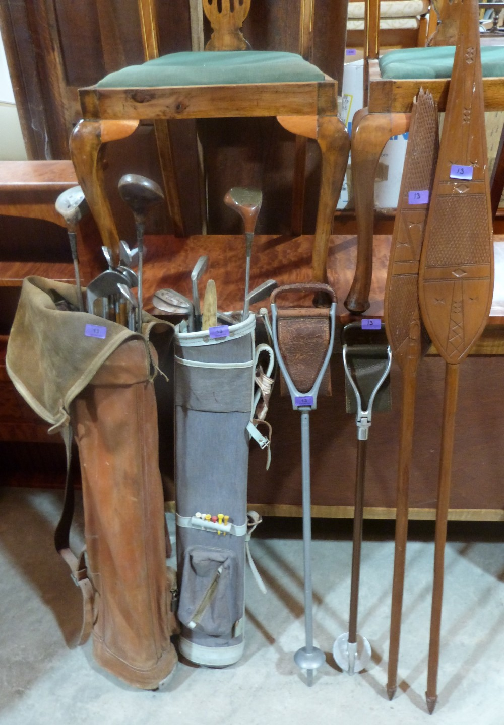 Lot 13 - A collection of hickory shafted and other golf clubs, two shooting sticks and two ethnic spears or