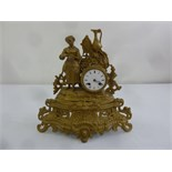 Lot 402 - A French style gilded metal mantle clock surmounted by a female figure with white enamel dial and