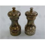Lot 349 - Two hallmarked silver pepper mills of customary form