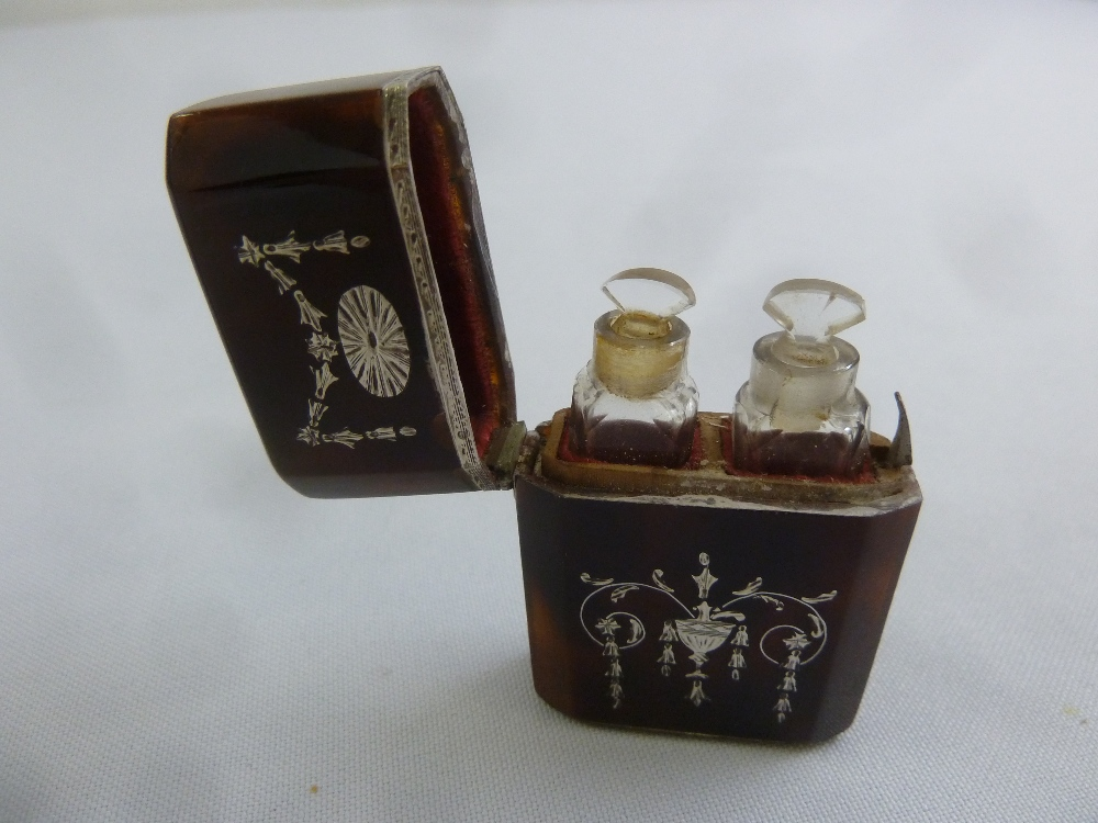 Lot 298 - A George III tortoiseshell and silver inlay scent bottle case of elongated octagonal form the hinged
