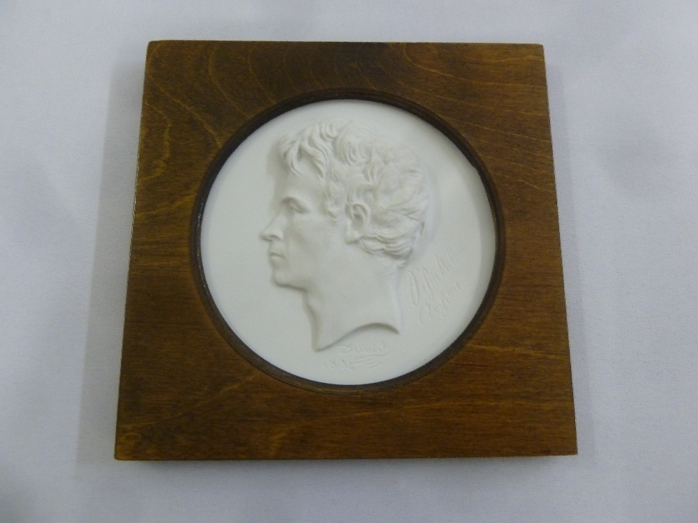 Lot 165 - A Meissen framed circular plaque mounted in a wooden frame of a man in profile, produced for the
