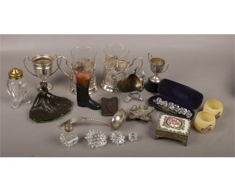A box of collectables including Russian silver plated demitasse cups, Swarovski hedgehogs and Art Nouveau style figural trink