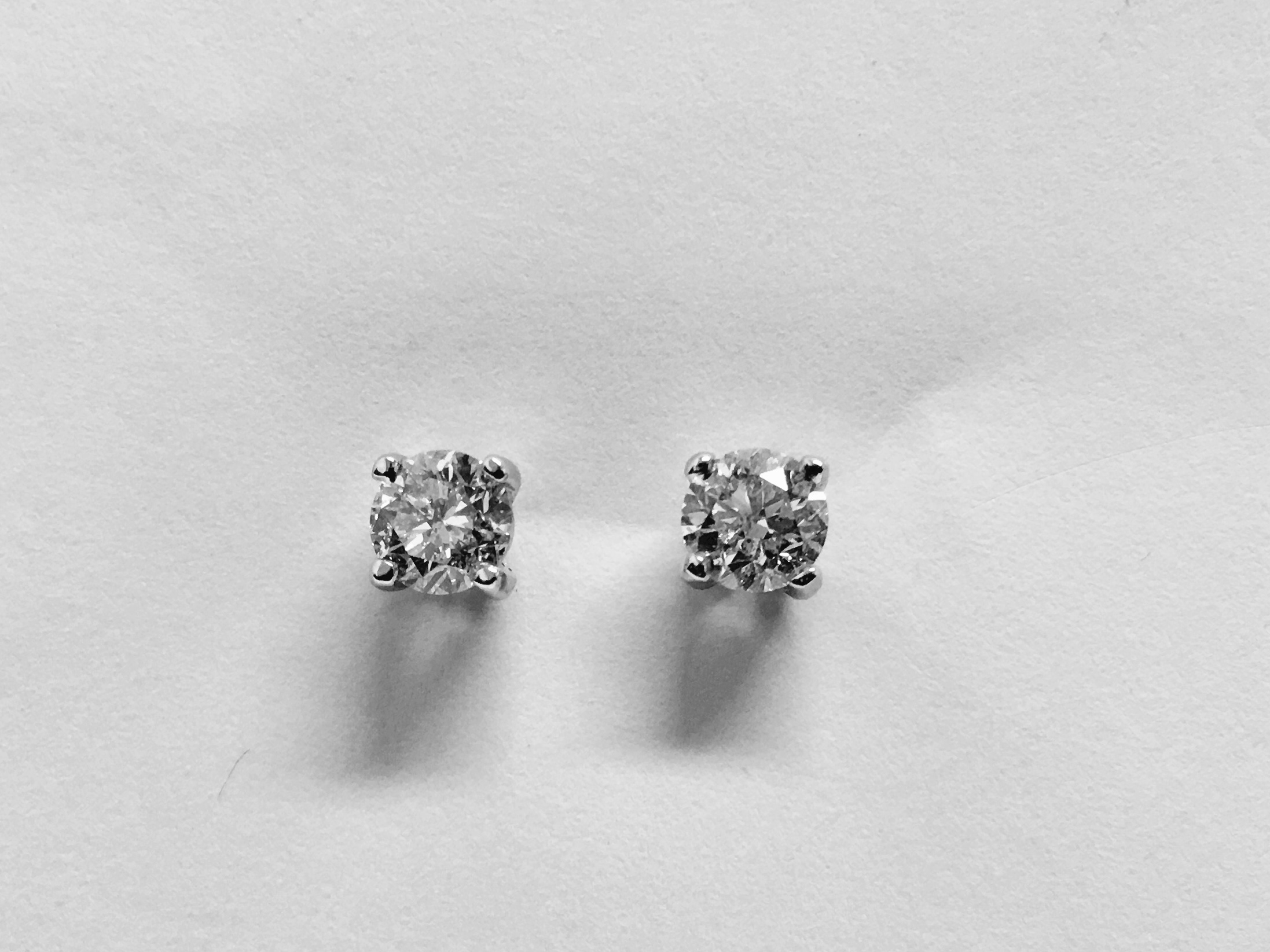Lot 7 - 0.60ct Solitaire diamond stud earrings set with brilliant cut diamonds, SI2 clarity and I colour.