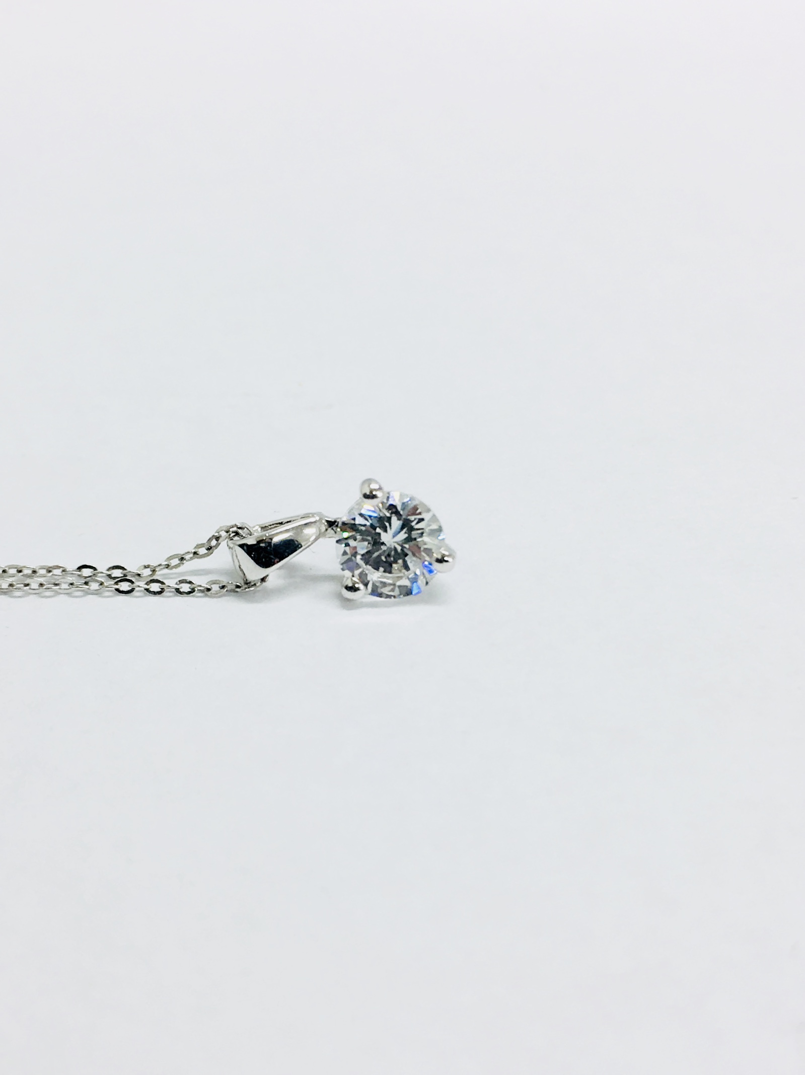 Lot 58 - 0.25ct diamond solitaire pendant set in 18ct gold. Brilliant cut diamond, I colour and si3