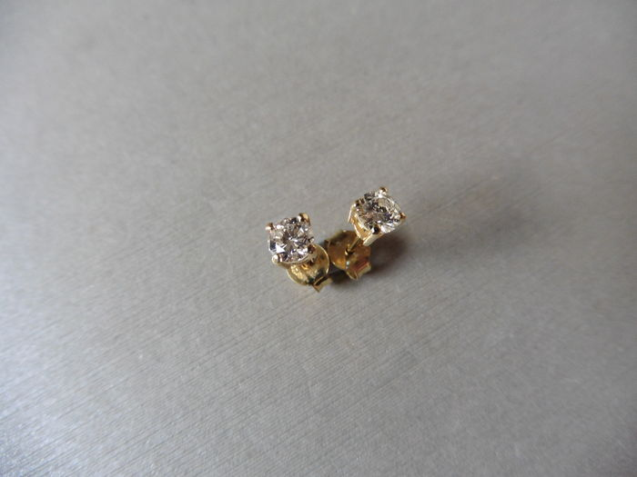 Lot 37 - 0.30ct Solitaire diamond stud earrings set with brilliant cut diamonds, SI2 clarity and I colour.