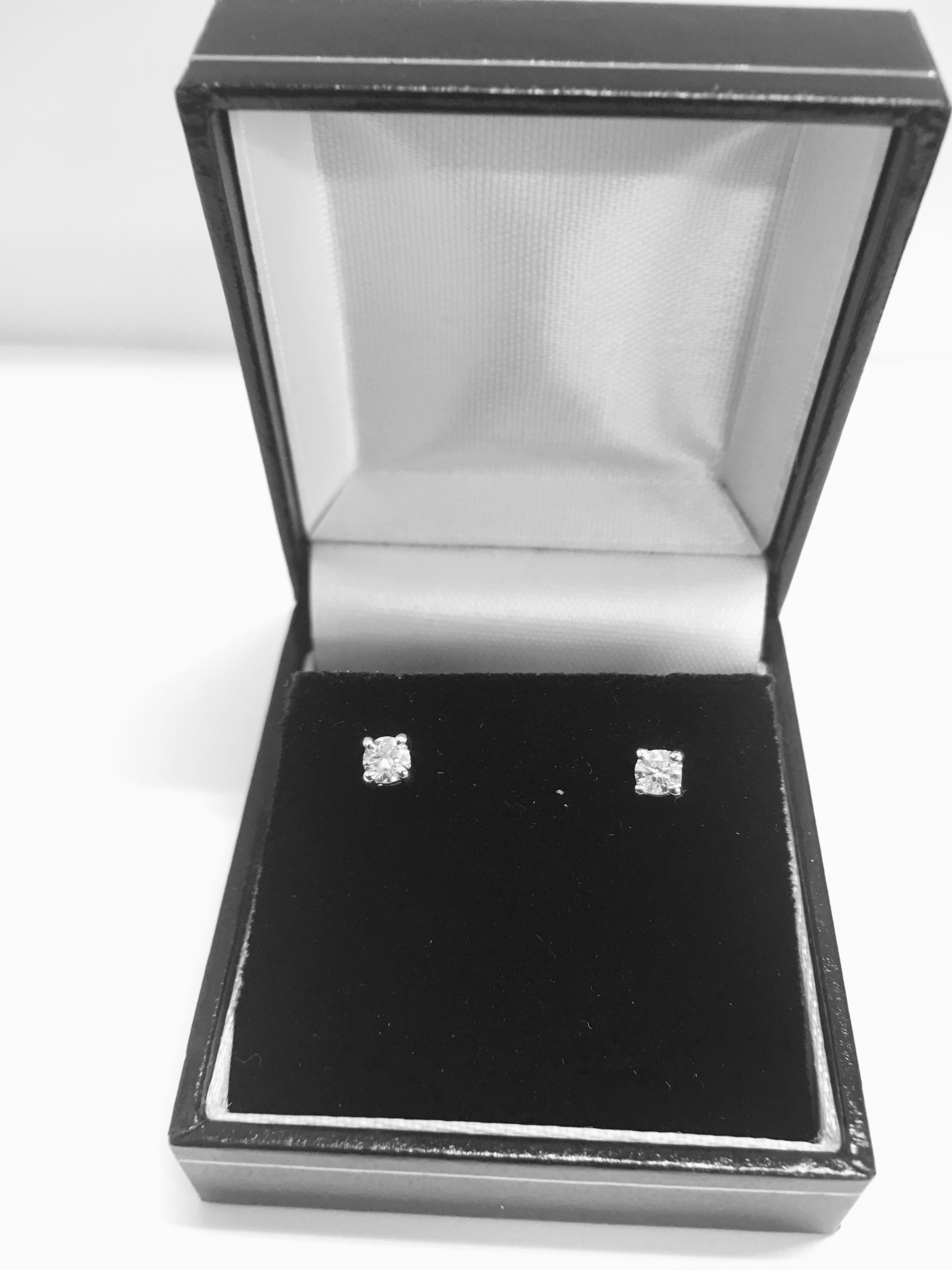 Lot 1 - 0.10ct Solitaire diamond stud earrings set with brilliant cut diamonds, i1 clarity and I colour. Set