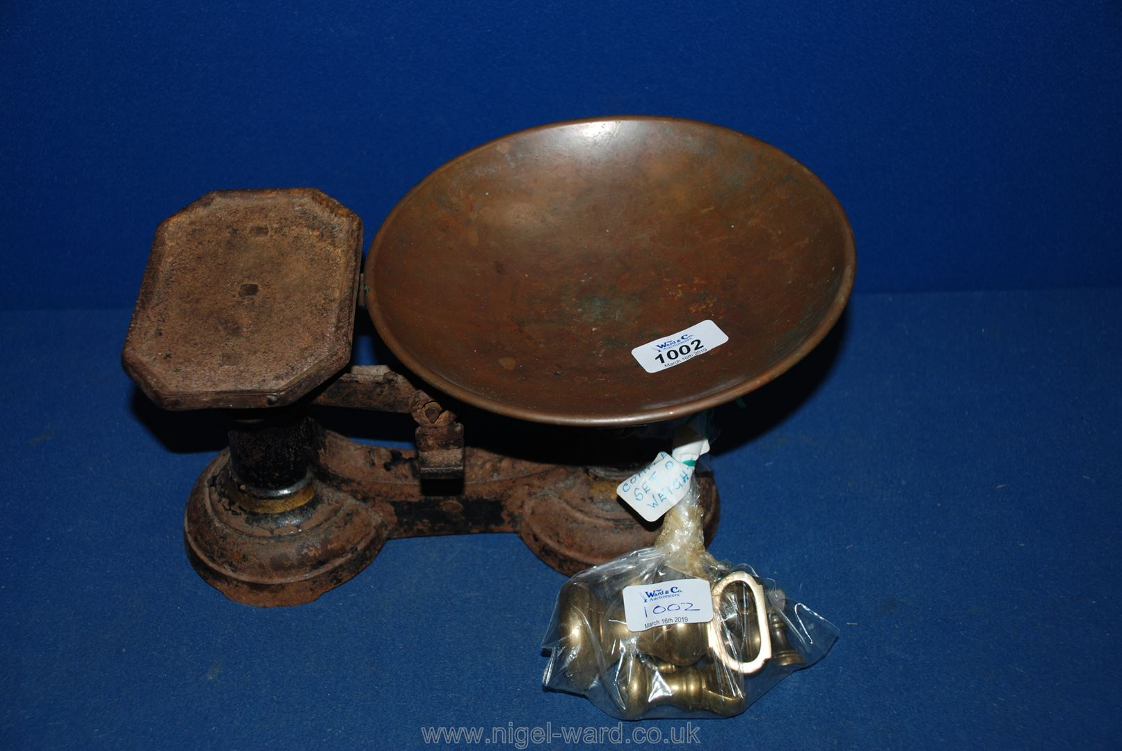 Lot 1002 - An old weighing scales with brass weights.