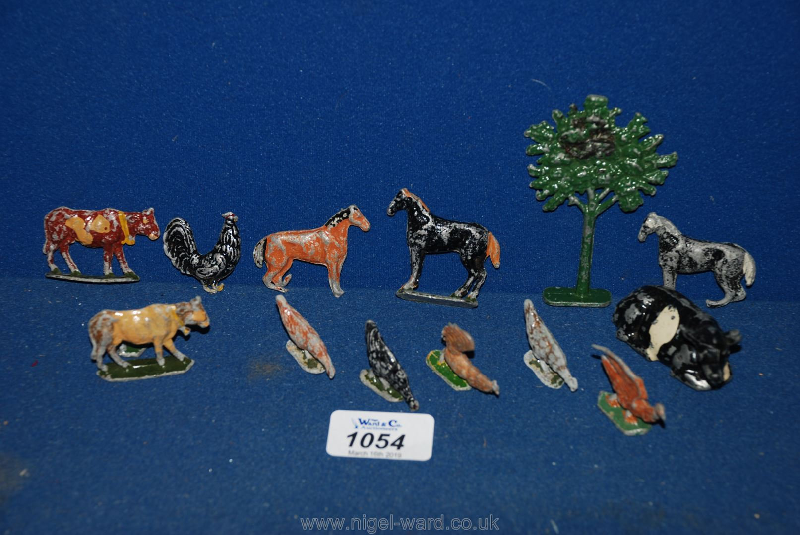 Lot 1054 - A small quantity of lead animals including cow, tree, chickens, horses, etc.