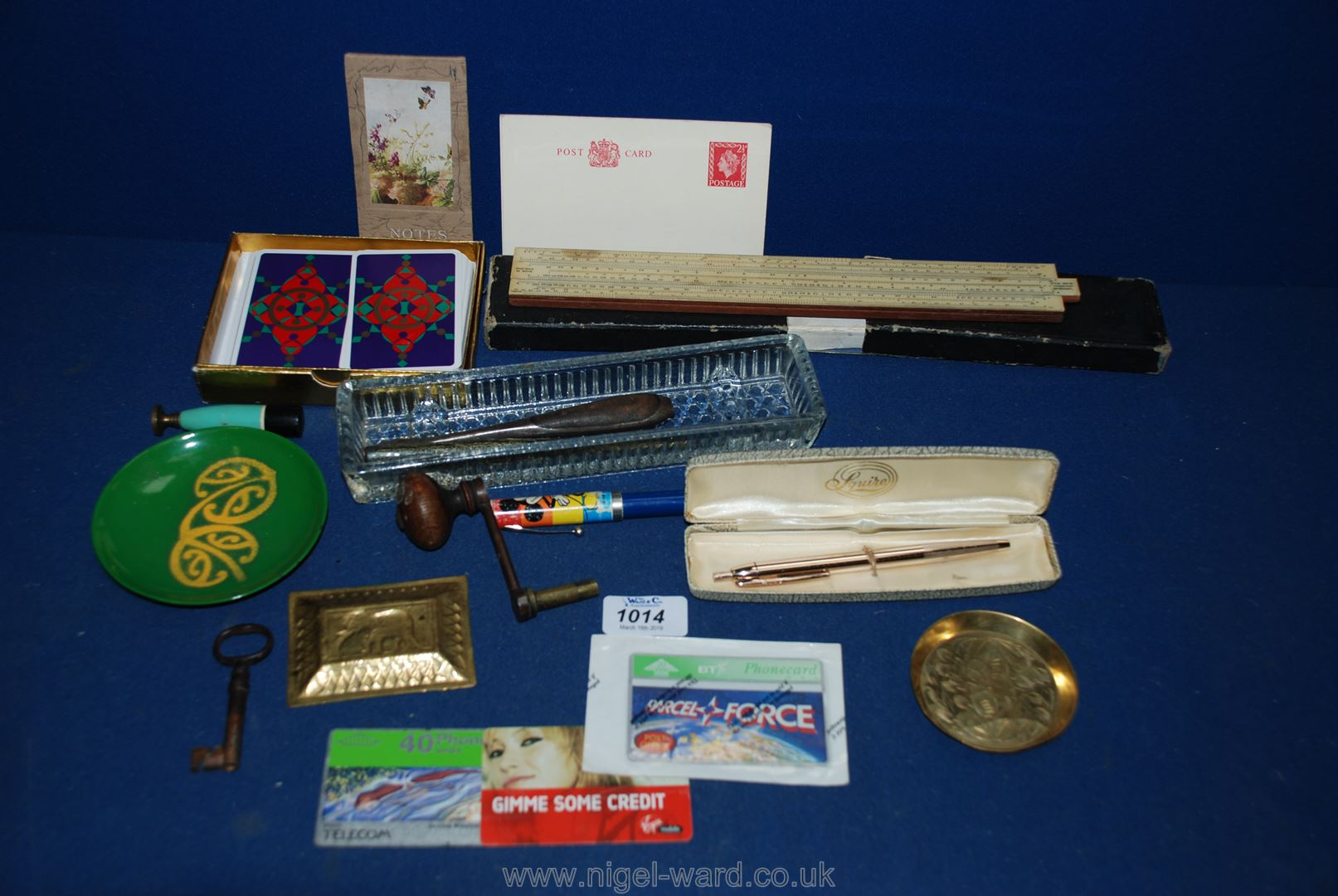 Lot 1014 - A box including clock winder, pen tray, slide rule, etc.