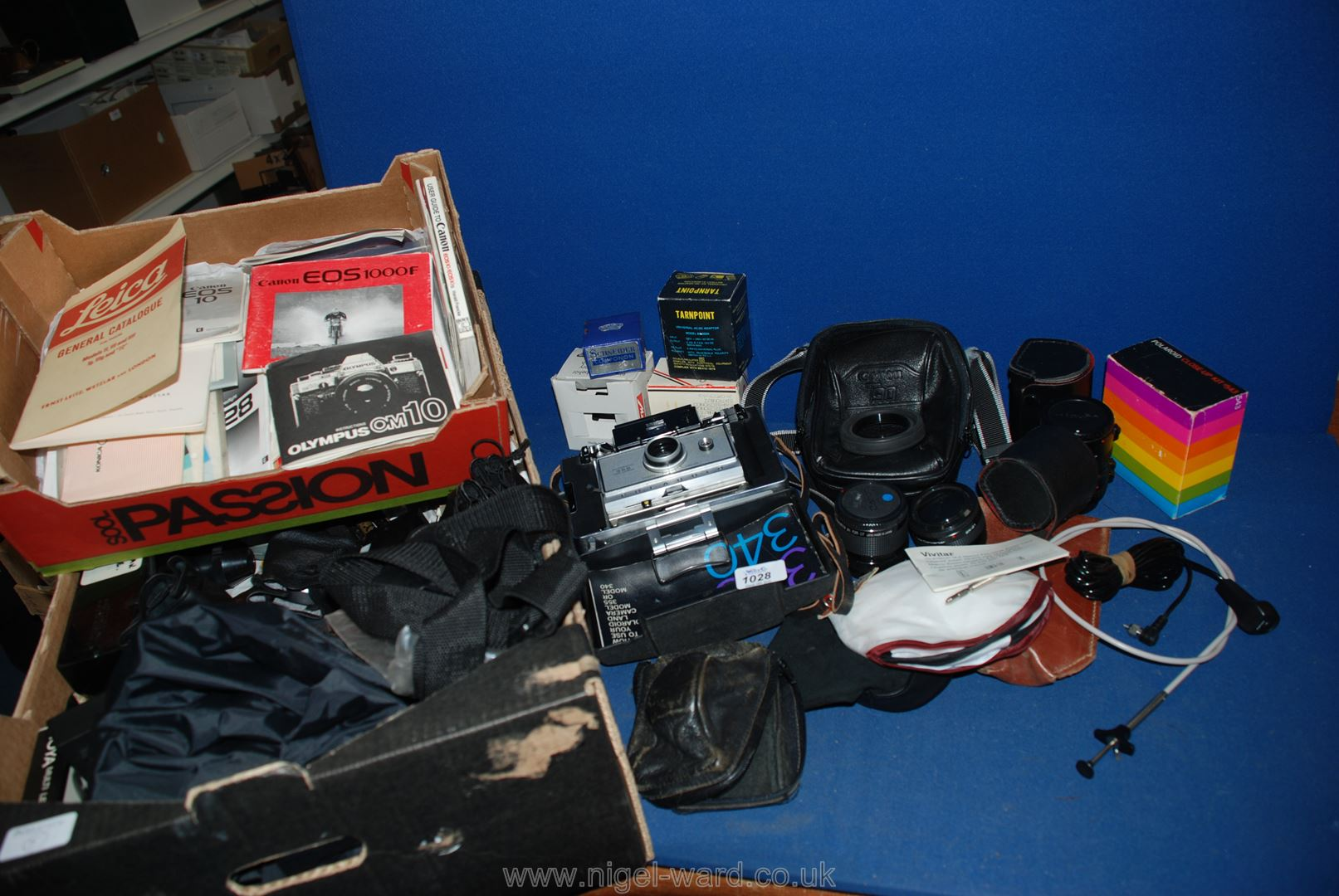 Lot 1028 - A large quantity of assorted camera equipment to include; lenses, dark room equipment,