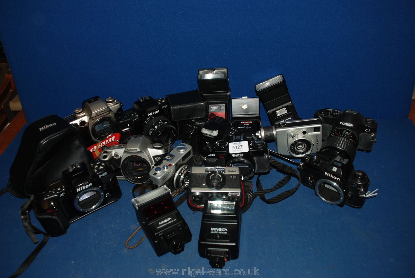 Lot 1027 - A large quantity of SLR film Cameras, lenses and flashes.