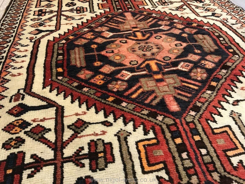 Lot 1055 - A hand-made Shiraz Rug, geometric design,