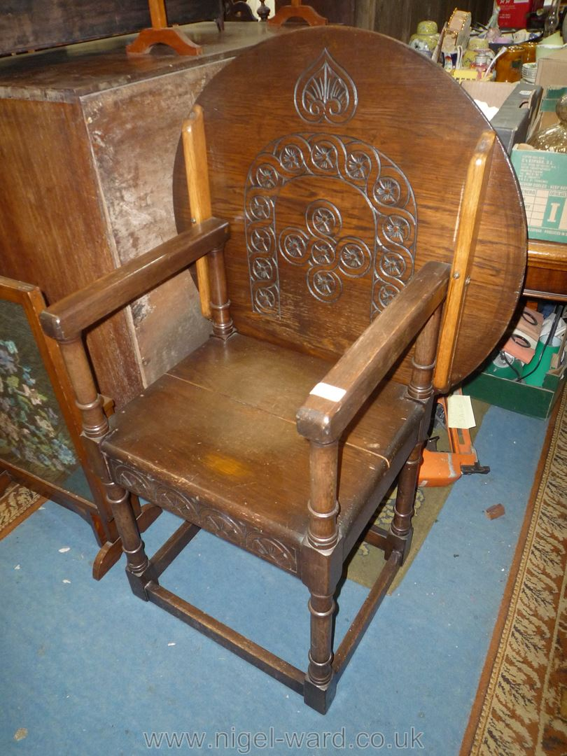 """Lot 1876 - An older reproduction Oak Monk's Seat, the top 27"""" diameter approx."""