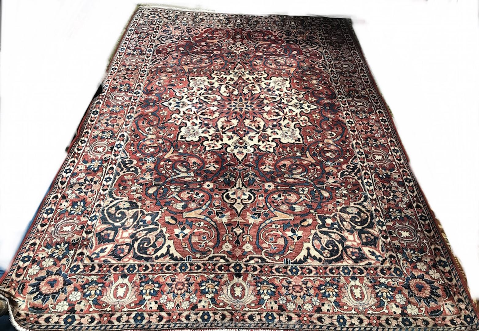 Lot 1060 - A large hand-made Kerman Carpet,
