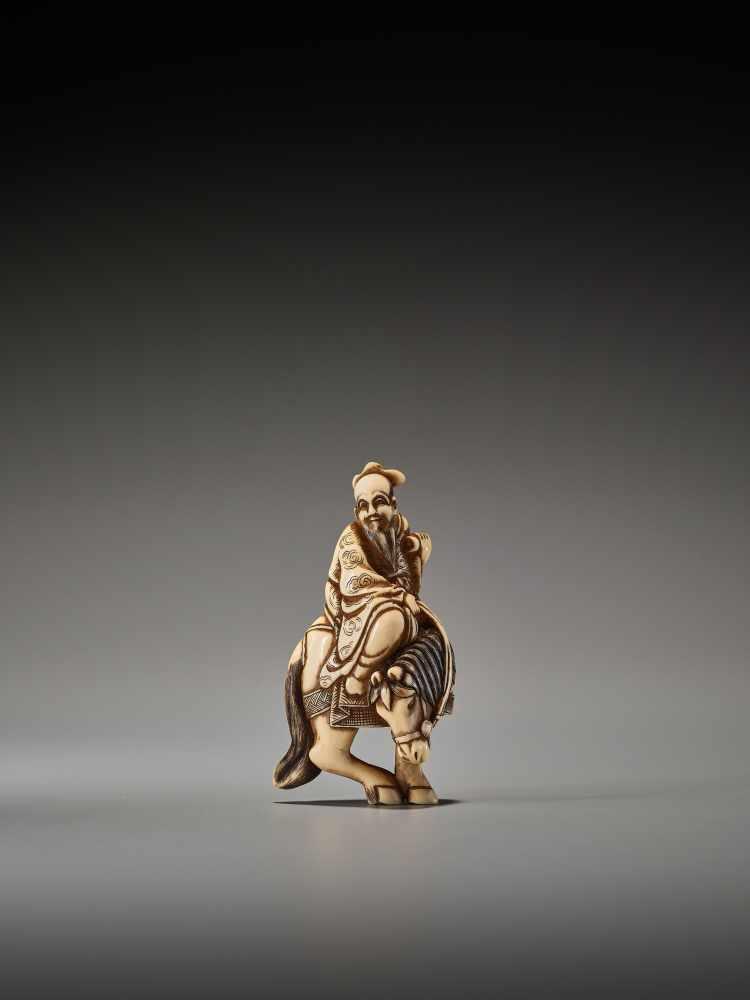 Los 12 - AN IVORY NETSUKE OF A TAOIST IMMORTAL ON HORSEBACK SIGNED MASANAOSigned Masanao, ivory netsukeJapan,