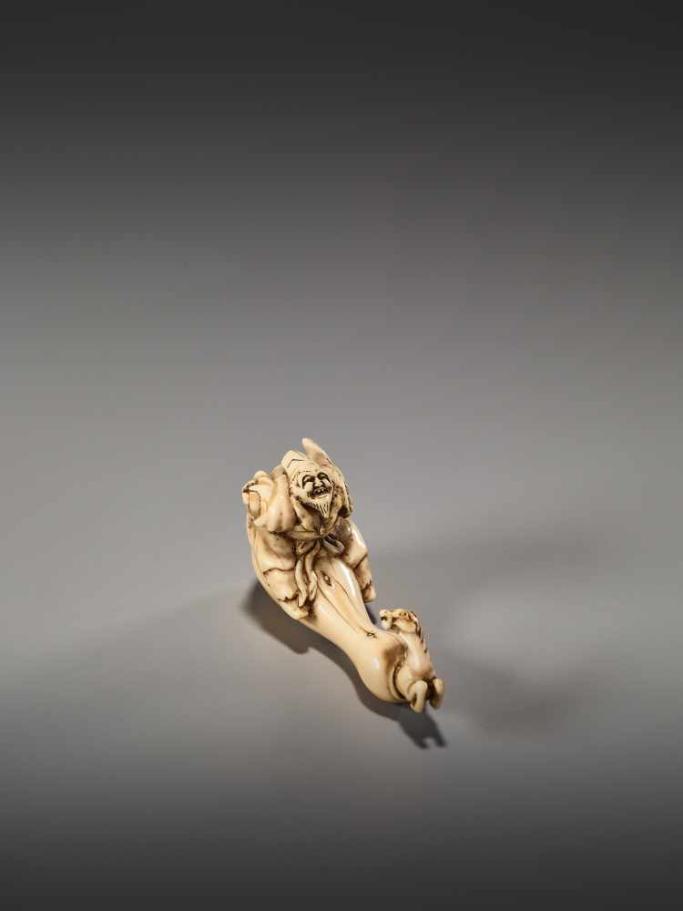 Lot 18 - AN AMUSING IVORY NETSUKE OF CHOKARO SENNIN WITH HIS HORSEUnsigned, ivory netsukeJapan, 19th century,