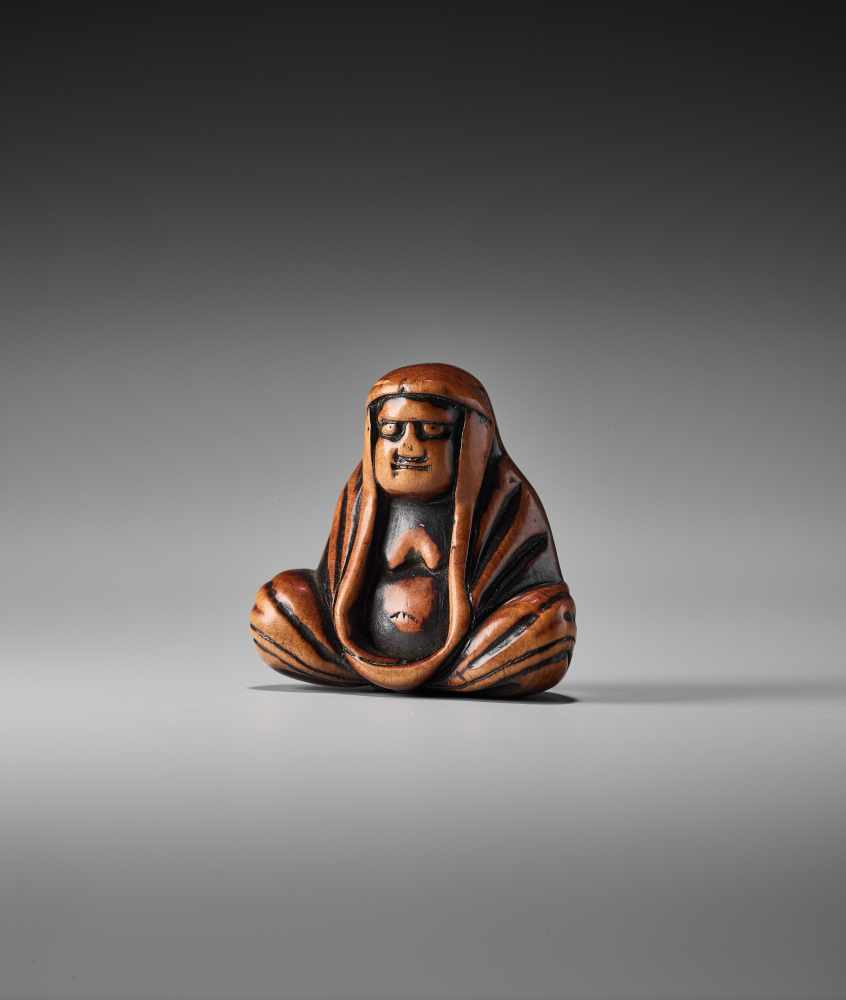 Lot 45 - A WOOD NETSUKE OF A MEDITATING DARUMAUnsigned, wood netsukeJapan, 19th century, Edo period (1615-