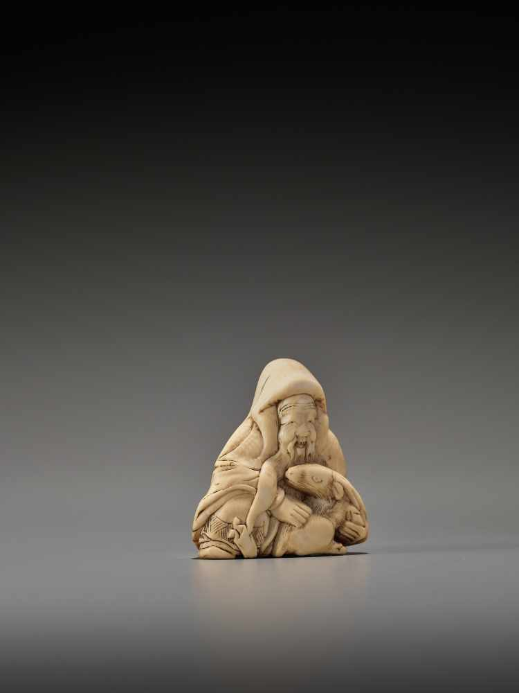 Los 35 - AN IVORY NETSUKE OF JUROJIN WITH STAGUnsigned, ivory netsukeJapan, 19th century, Edo period (1615-
