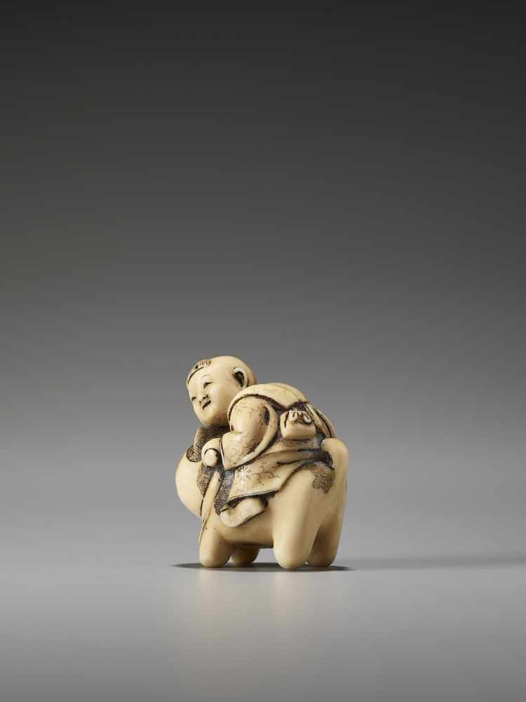 Los 28 - A CHARMING IVORY NETSUKE OF A BOY RIDING A CATUnsigned, ivory netsukeJapan, late 19th century, Meiji