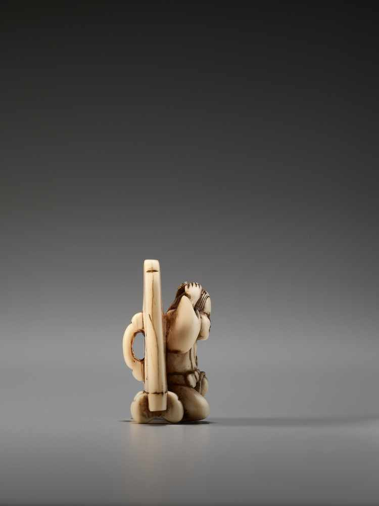 Lot 47 - AN IVORY NETSUKE OF OKAME IN FRONT OF A SCREEN BY HIDEMASABy Hidemasa, ivory netsukeJapan, Osaka,