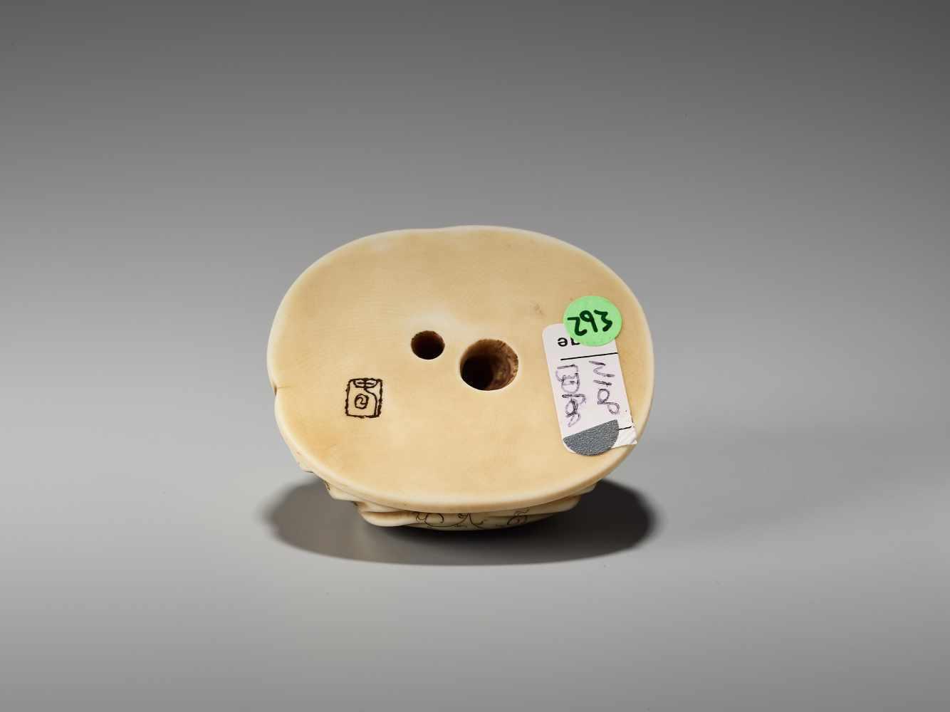 Lot 30 - AN IVORY NETSUKE OKIMONO OF A BOY IN HOTEI'S BAGSigned in seal form Tanaka, ivory netsuke-