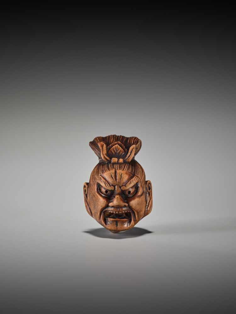 Los 43 - A WOOD NETSUKE OF A SEVERED NIO HEADUnsigned, wood netsukeJapan, 19th century, Edo period (1615-